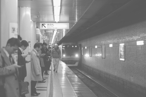 PEOPLE WAITING TRAIN IN TOYOCO STATION bw